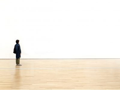 Woman,Watching,Blank,Space,Wall,In,Modern,Gallery,,Art,Exhibition